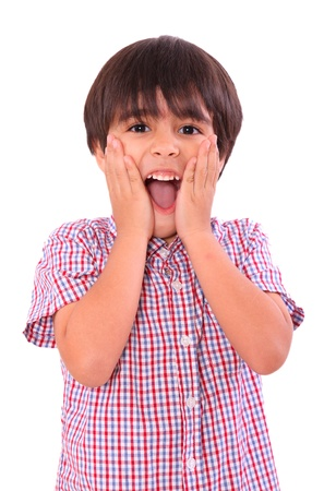 surprised child: Young child surprised with hands on his face, over white background. Six years old