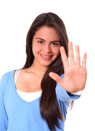 stop hand: woman smiling saying stop with hand isolated over white background