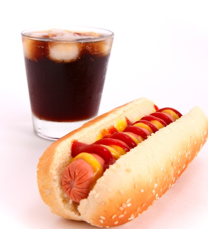 bread soda: black drink and hot dog over lettuce over white background Stock Photo