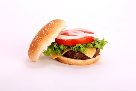 burger background: open hamburger with bread,tomato,onion,lettuce,meat,cheese,ham, isolated over white background  Stock Photo