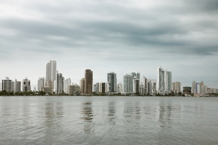 buildings beside sea with cloudy sky background. photography