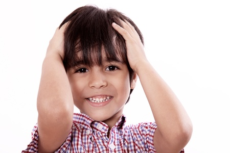 child with hands on head and smiling, white background photo