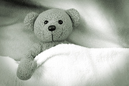 sick teddy bear: Teddy bear sleeping sleeping with a blanket Stock Photo