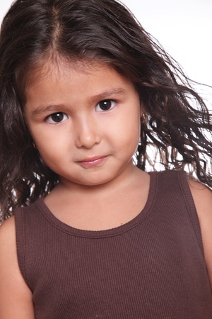 serious child girl with brown blouse. close up photo