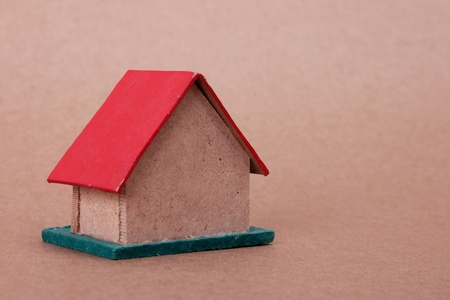 red cardboard house over cardboard. close up photo