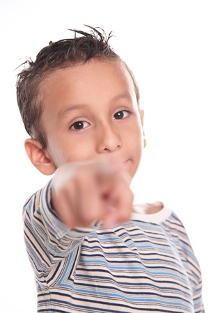Child looking and pointing the camera, on white background photo