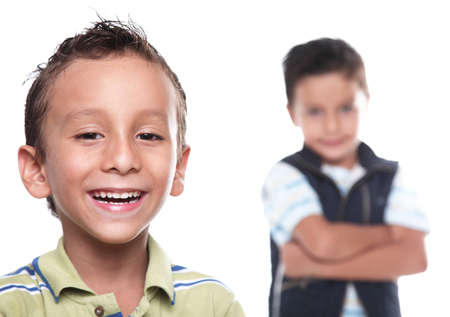 Children smiling and looking at the camera, white background photo