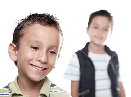Children smiling on white background, selective focus photo