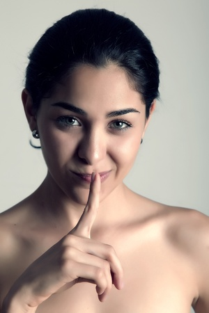 Young woman looking at the camera, silence expression photo