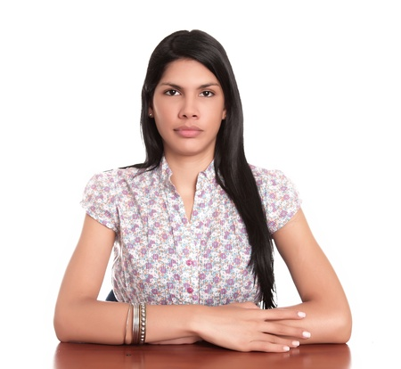 serious face: young woman serious, on desk over white background Stock Photo