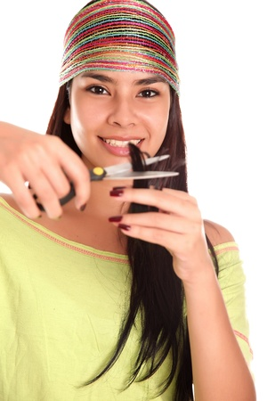 woman cutting her hair with scissors, white background photo