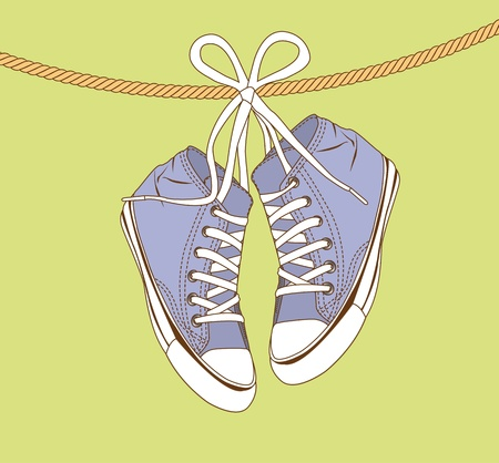 plimsolls: violet sneakers hanging of a rope over green background.