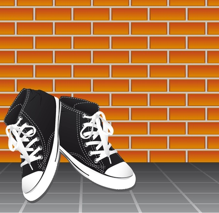 plimsolls: black sneakers over floor and bricks wall, background