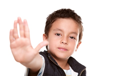 7 years old boy making a stop signal with his hand Stock Photo
