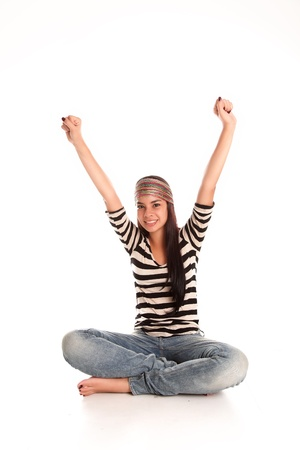 young woman with raised arms in a sign of relaxation photo