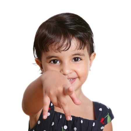 dedo se�alando: Chica hermosa feliz apuntando a la c�mara sobre fondo blanco Foto de archivo