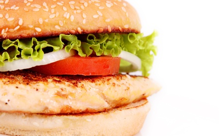 delicious chicken burger with lettuce and tomato photo