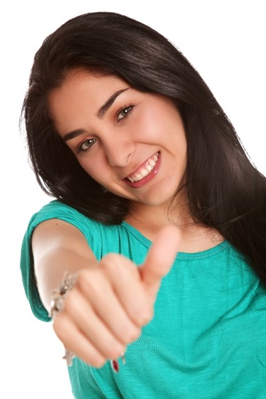 beautiful woman with finger raised in signal of ok photo