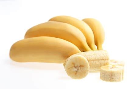 banana peel: Bananas with peeled and chopped one isolated on white Fruit