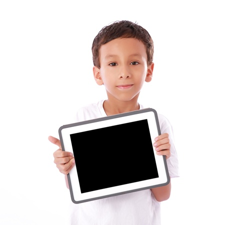 Boy showing a  tablet isolated over white background  photo
