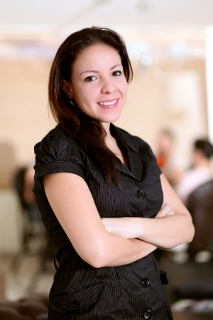 Casual woman looking at camera with arms crossed  photo