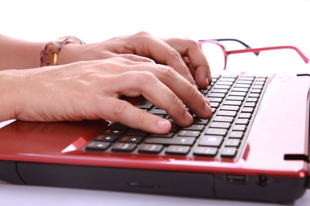 hands typing a red notebook a sign of labor and technology Stock Photo - 18610387