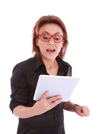 Surprised woman looking at the information from your tablet Stock Photo