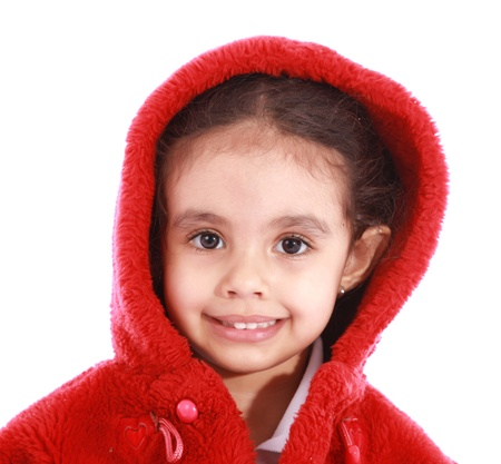 Beauty child girl  looking at the camera with red hood over white background photo