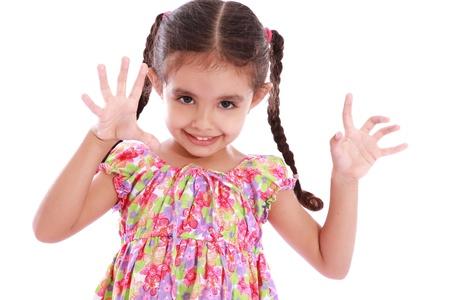 ten empty: Happy girl  showing ten fingers over white background