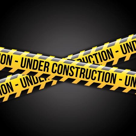 under construction ribbons over black background