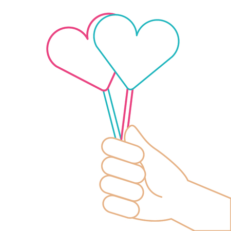Hand holding heart lollipops