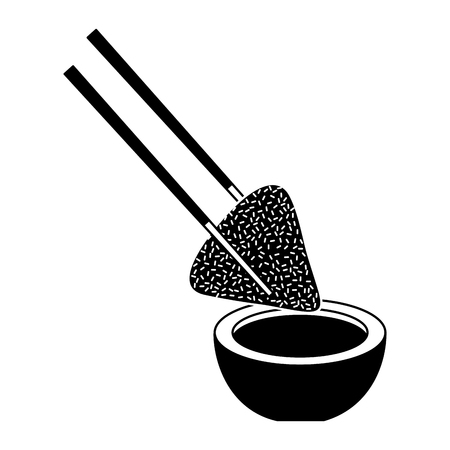Dumpling rice plate and soy sauce with chopsticks.