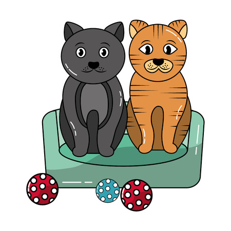 two cats sitting in the bed with balls toy vector illustration Stock Photo