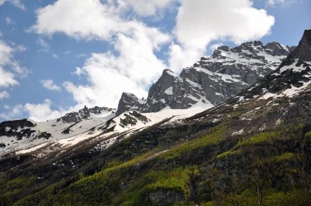 dombai: mountains, snow, forest, dombai, clouds, sky, rocks Stock Photo