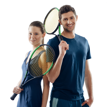 Happy tennis players on white. Woman and man holding racquets and showing enjoyment of game they had.