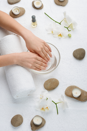 Soaking nails in warm water. Moistening cuticle before removing it. Resting and getting an elegant look for hands.