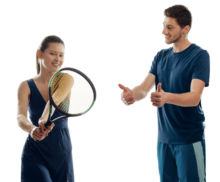 Coach praises his trainee for a good job and showing thumbs up. Woman and man in sportswear on white. Learning to play tennis.