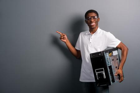 Good-looking man holding computer Foto de archivo