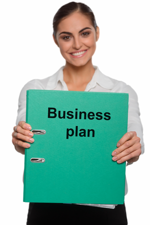 Happy businesswoman with a brilliant plan Stock Photo