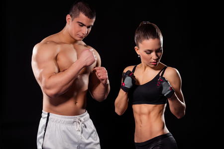 Muscular couple in poxing pose. Stock Photo
