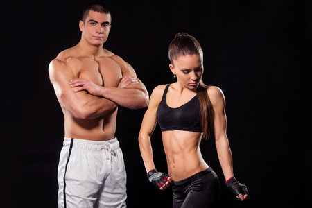 Fit couple showing muscles. Stock Photo