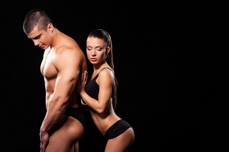 Fitness model leaning on athlete. Stock Photo
