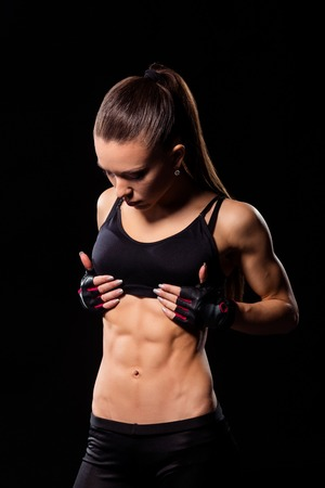 Attractive lady showing abs.