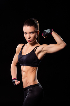 Female athlete flexing bicep.