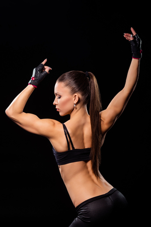 Woman flexing arm and shoulder.