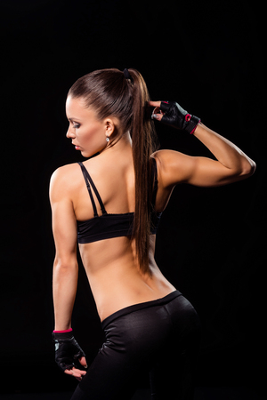 Woman flexing back and tricep.