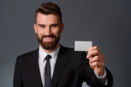 Businessman holding a blank visit card Фото со стока