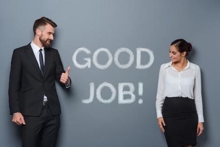 Business leader congratulates his employee