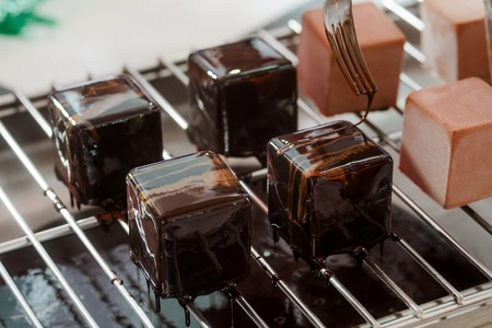 Decorating chocolate mousse cakes Stock Photo