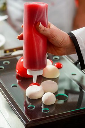 Strawberry sauce and yogurt spheres